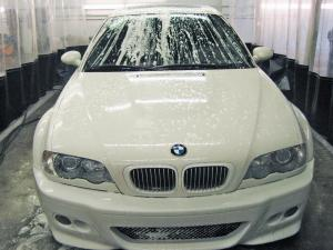 White BMW in the wash bay
